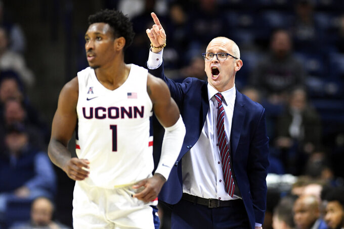Connecticut head coach Dan Hurley yells instructions to his team including Connecticut's Christian Vital (1) in the first half of an NCAA college basketball game against Tulane Wednesday, Jan. 8, 2020, in Storrs, Conn. (AP Photo/Stephen Dunn)