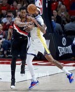 Portland Trail Blazers center Hassan Whiteside, left, and Golden State Warriors center Willie Cauley-Stein collide during the first half of an NBA basketball game in Portland, Ore., Monday, Jan. 20, 2020. (AP Photo/Craig Mitchelldyer)