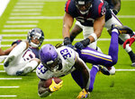Minnesota Vikings running back Dalvin Cook (33) dives for extra yards against the Houston Texans during the first half of an NFL football game Sunday, Oct. 4, 2020, in Houston. (AP Photo/David J. Phillip)