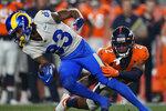 Denver Broncos cornerback Pat Surtain II (2) tackles Los Angeles Rams wide receiver Trishton Jackson (83) during the first half of an NFL preseason football game, Saturday, Aug. 28, 2021, in Denver. (AP Photo/David Zalubowski)