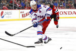 New York Rangers right wing Jesper Fast (17) passes the puck during the first period of the team's NHL hockey game against the New Jersey Devils, Thursday, Oct. 17, 2019, in Newark, N.J. (AP Photo/Kathy Willens)