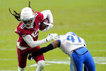 Arizona Cardinals wide receiver DeAndre Hopkins (10) eludes the grasp of Detroit Lions cornerback Chris Jones (41) during the second half of an NFL football game, Sunday, Sept. 27, 2020, in Glendale, Ariz. (AP Photo/Ross D. Franklin)