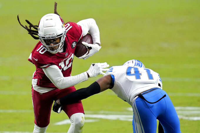 Arizona Cardinals wide receiver DeAndre Hopkins (10) eludes the grasp of Detroit Lions cornerback Chris Jones (41) during the second half of an NFL football game, Sunday, Sept. 27, 2020, in Glendale, Ariz. (AP Photo/Ross D. Franklin)