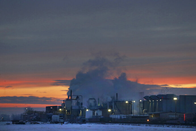 FILE - In this Jan. 11, 2016 file photo, dawn approaches over the meat processing plant owned and run by Cargill Meat Solutions, in Fort Morgan, a small town on the eastern plains of Colorado. The U.S. Equal Employment Commission said Friday, Sept. 14, 2018 that Cargill has agreed to pay $1.5 million to 138 Somali-American Muslim workers who were fired from the plant in 2016 after they were refused prayer breaks. (AP Photo/Brennan Linsley, File)