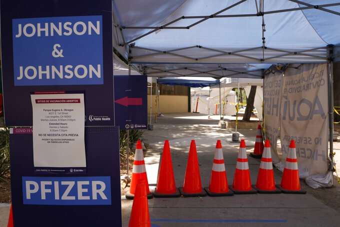 Banners advertise the availability of Johnson & Johnson and Pfizer COVID-19 vaccines at a county-run vaccination site at the Eugene A. Obregon Park in Los Angeles Thursday, July 22, 2021. The top health official in Los Angeles County on Thursday implored residents to get vaccinated as the region experiences a coronavirus surge similar to last summer's.(AP Photo/Damian Dovarganes)