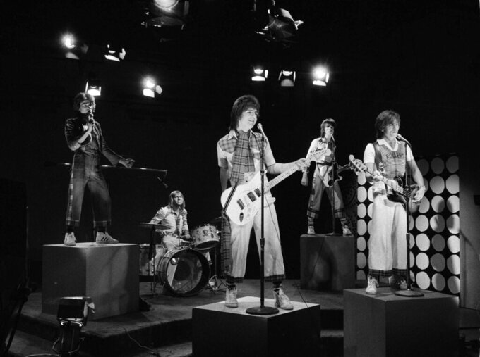 """FILE - In this Jan. 16, 1976 file photo, Scottish pop group the Bay City Rollers are seen performing during the taping of a local New York City kids' television program """"Wonderama"""". McKeown, the former lead singer of 1970s pop sensation Bay City Rollers, has died suddenly at the age of 65, his family said Thursday, April 22, 2021.  A statement from his family posted on social media said: """"It is with profound sadness that we announce the death of our beloved husband and father Leslie Richard McKeown."""" (AP Photo/Marty Lederhandler, file)"""