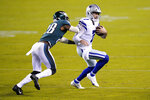 Dallas Cowboys' Ben DiNucci (7) is hit by Philadelphia Eagles' Will Parks (28) during the second half of an NFL football game, Sunday, Nov. 1, 2020, in Philadelphia. (AP Photo/Chris Szagola)