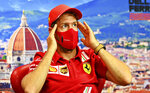 Ferrari driver Sebastian Vettel of Germany attends a media conference at the Mugello racetrack, in Scarperia, Italy, Thursday, Sept. 10, 2020, ahead of Sunday's Formula One Grand Prix of Tuscany. (Clive Mason, Pool Photo via AP)