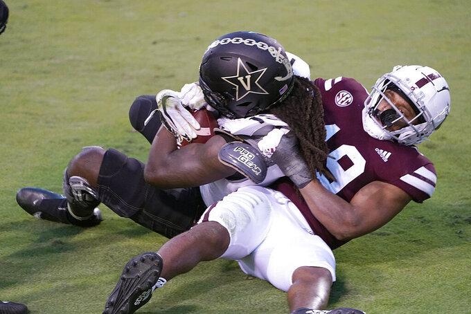 Vanderbilt wide receiver Chris Pierce Jr. (19) holds on to a 2-yard touchdown pass reception as Mississippi State safety Collin Duncan (19) tries to wrestle the ball from him during the second half of an NCAA college football game in Starkville, Miss., Saturday, Nov. 7, 2020. (AP Photo/Rogelio V. Solis)