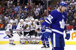 Chicago Blackhawks centre Drake Caggiula (91) celebrates his goal with teammates during first period NHL hockey action against the Toronto Maple Leafs, in Toronto, Saturday, Jan. 18, 2020. (Cole Burston/The Canadian Press via AP)