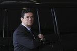 Former Brazilian Judge Sergio Moro, who was appointed Justice Minister by President-elect Jair Bolsonaro, arrives to his team's transition office, in Brasilia, Brazil, Tuesday, Dec. 4, 2018. Bolsonaro will be sworn in as Brazil's next president on Jan. 1, 2019. (AP Photo/Eraldo Peres)
