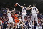 Gonzaga forward Corey Kispert, second from the right, blocks a shot by Pacific guard Broc Finstuen, second from the left, in front of teammates Drew Timme, left, and Killian Tillie during the second half of an NCAA college basketball game in Spokane, Wash., Saturday, Jan. 25, 2020. Gonzaga won 92-59. (AP Photo/Young Kwak)