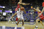 Washington forward Jaden McDaniels (0) looks to pass the ball as Arizona guard Josh Green leaps next to him during the first half of an NCAA college basketball game Thursday, Jan. 30, 2020, in Seattle. (AP Photo/Ted S. Warren)