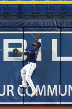 Tampa Bay Rays left fielder Manuel Margot goes up but can't make the catch on a solo home run by Philadelphia Phillies' Andrew McCutchen during the fifth inning of a baseball game Saturday, Sept. 26, 2020, in St. Petersburg, Fla. (AP Photo/Chris O'Meara)