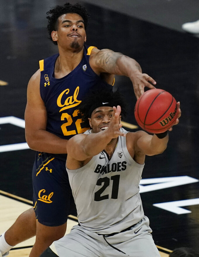 California's Andre Kelly (22) and Colorado's Evan Battey (21) battle for a rebound during the second half of an NCAA college basketball game in the quarterfinal round of the Pac-12 men's tournament Thursday, March 11, 2021, in Las Vegas. (AP Photo/John Locher)