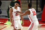 Houston guard Quentin Grimes, left, celebrates his 3-point basket with Fabian White Jr. during the first half of an NCAA college basketball game against South Florida, Sunday, Feb. 28, 2021, in Houston. (AP Photo/Eric Christian Smith)