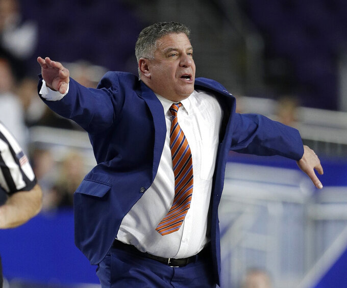 Auburn head coach Bruce Pearl directs his team during the first half against Virginia in the semifinals of the Final Four NCAA college basketball tournament, Saturday, April 6, 2019, in Minneapolis. (AP Photo/David J. Phillip)