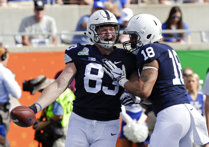 Penn State tight end Nick Bowers (83) celebrates his 1-yard touchdown reception against Kentucky with wide receiver Clevan Thomas Jr. (18) during the first half of the Citrus Bowl NCAA college football game, Tuesday, Jan. 1, 2019, in Orlando, Fla. (AP Photo/John Raoux)