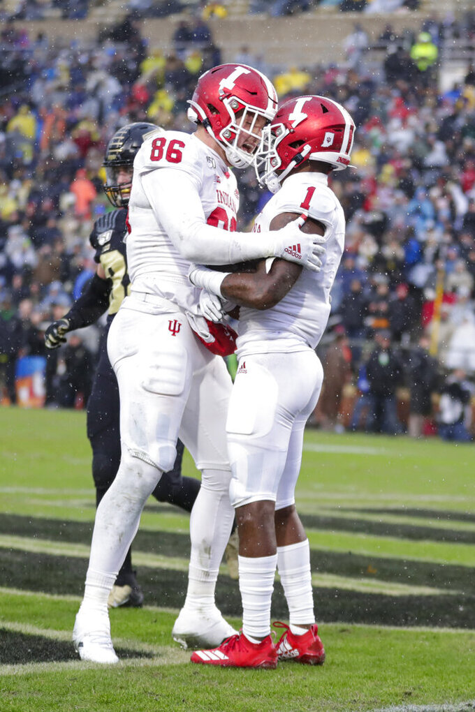 Indiana wide receiver Whop Philyor (1) celebrates a touchdown catch against Purdue with tight end Peyton Hendershot (86) during the first half of an NCAA college football game in West Lafayette, Ind., Saturday, Nov. 30, 2019. (AP Photo/Michael Conroy)