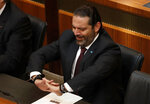 Lebanese Prime Minister Saad Hariri, gestures during the opening session on the draft 2019 state budget, at the parliament building, in Beirut, Lebanon, Tuesday, July 16, 2019. The lawmakers have begun discussing the draft 2019 state budget amid tight security and limited protests against proposed austerity measures. The proposed budget aims to avert a financial crisis by raising taxes and cutting public spending in an effort to reduce a ballooning deficit. (AP Photo/Hussein Malla)