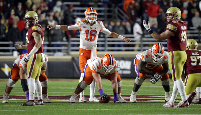 Clemson quarterback Trevor Lawrence (16) calls signals at the line of scrimmage during the first half of the team's NCAA college football game against Boston College, Saturday, Nov. 10, 2018, in Boston. (AP Photo/Elise Amendola)