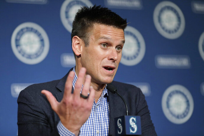 FILE - In this Jan. 23, 2020, file photo, Seattle Mariners general manager Jerry Dipoto speaks in Seattle. For a number of rebuilding teams, the 2020 baseball season was supposed to be another step in the progression of their top prospects eventually reaching the big leagues. By the time June rolled around, Dipoto expected former first-round pick Logan Gilbert to be pitching on the mound at T-Mobile Park. (AP Photo/Ted S. Warren, File)