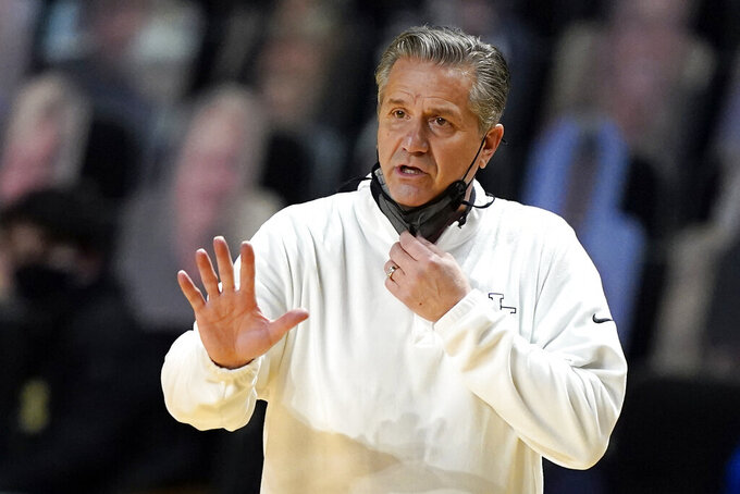 FILE - In this Feb. 17, 2021, file photo, Kentucky head coach John Calipari gestures during the first half of an NCAA college basketball game against Vanderbilt in Nashville, Tenn. Calipari is awaiting a pivotal rulings on the eligibility of transfers before he will know who'll be around to help the Wildcats bounce back from the coach's first losing season in Lexington. (AP Photo/Mark Humphrey, File)
