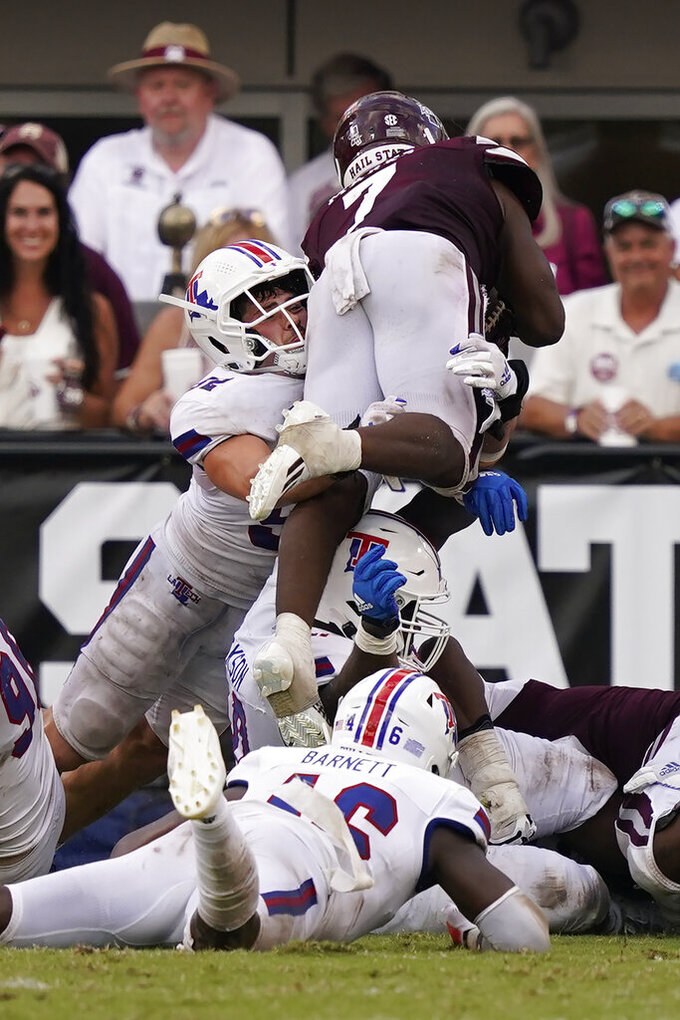 Mississippi State running back Jo'quavious Marks (7) dives over Louisiana Tech defenders for a short yardage touchdown during the second half of an NCAA college football game in Starkville, Miss., Saturday, Sept. 4, 2021. Mississippi State won 35-34. (AP Photo/Rogelio V. Solis)