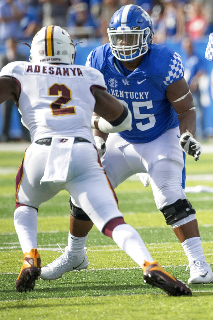 FILE - In this Sept. 1, 2018, photo, Kentucky guard Bunchy Stallings (65) blocks Central Michigan defensive lineman Sean Adesanya (2) at the line of scrimmage during the first half of a game in Lexington, Ky. Stallings was named to the 2018 AP All-America NCAA college football team, Monday, Dec. 10, 2018.  (AP Photo/Bryan Woolston)