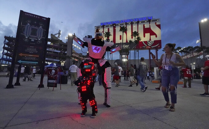 Dancers perform outside Raymond James Stadium before an NFL football game between the Tampa Bay Buccaneers and the Dallas Cowboys Thursday, Sept. 9, 2021, in Tampa, Fla. (AP Photo/Chris O'Meara)