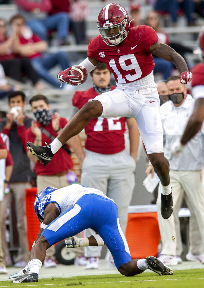 Alabama tight end Jahleel Billingsley (19) hurdles Kentucky defensive back Kelvin Joseph (1) after a catch during NCAA college football game at Bryant-Denny Stadium, Saturday, Nov. 21, 2020, in Tuscaloosa, Ala. (Mickey Welsh/The Montgomery Advertiser via AP)