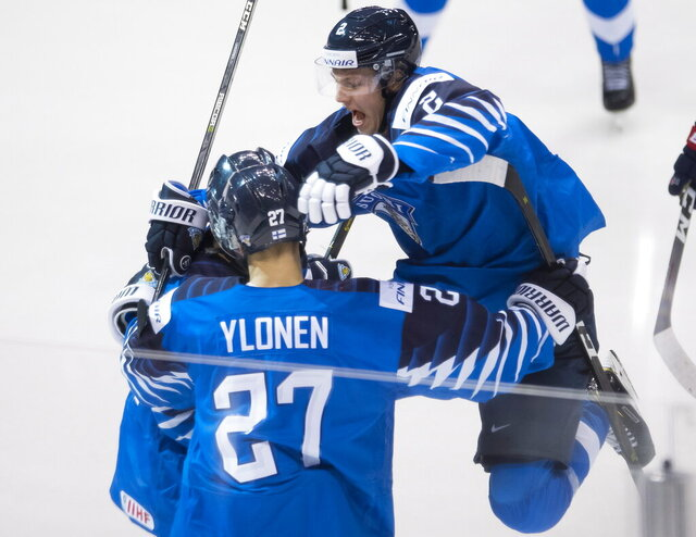 FILE - In this Jan. 5, 2019, file photo, Finland's Oskari Laaksonen jumps into the arms of Jesse Ylonen celebrating Ylonen's goal during the second period of the gold medal game at the world junior hockey tournament against the United States, in Vancouver, British Columbia. The Buffalo Sabres signed defenseman Oskari Laaksonen to a three-year entry-level contract on Monday, June 15, 2020. Laaksonen was Buffalo's third-round pick in the 2017 draft and spent the past two-plus seasons playing in Finland's Elite League. (Jonathan Hayward/The Canadian Press via AP, File)