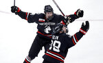 Northeastern forward Zach Solow, right, celebrates his goal against Boston College with forward Lincoln Griffin, rear left, during the third period of the NCAA hockey Beanpot tournament championship game in Boston, Monday, Feb. 11, 2019. Northeastern won 4-2. (AP Photo/Charles Krupa)