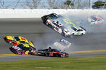 Joey Logano (22), Jimmie Johnson (48), Clint Bowyer (14) and Austin Dillon (3) are involved in a multi-car wreck in Turn 4 along with Denny Hamlin (11), Aric Almirola (10), Kurt Busch (1), Kevin Harvick (4) and Erik Jones (20) during the NASCAR Busch Clash auto race at Daytona International Speedway, Sunday, Feb. 9, 2020, in Daytona Beach, Fla. (AP Photo/Darryl Graham)