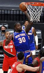 New York Knicks forward Julius Randle (30) drives to the basket on Portland Trail Blazers guard Damian Lillard, left, during the first quarter of an NBA basketball game in Portland, Ore., Sunday, Jan. 24, 2021. (AP Photo/Steve Dykes)