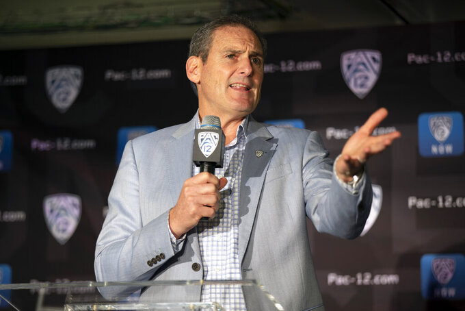 FILE - In this Oct. 8, 2019, file photo, Pac-12 commissioner Larry Scott speaks during the Pac-12 NCAA college basketball media day in San Francisco. Scott's volatile 11-year tenure as Pac-12 commissioner is in its final month. The conference announced in January he would be stepping down June 30, 2021. (AP Photo/D. Ross Cameron, File)