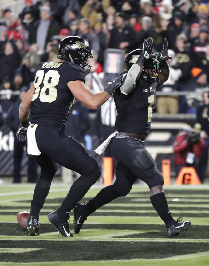 Purdue running back D.J. Knox (1) celebrates his touchdown against Ohio State with Purdue tight end Cole Herdman (88) during the second half of an NCAA college football game in West Lafayette, Ind., Saturday, Oct. 20, 2018. Purdue defeated Ohio State 49-20. (AP Photo/Michael Conroy)