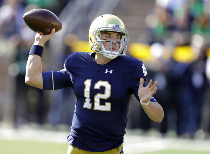 Notre Dame quarterback Ian Book throws during the first half of an NCAA college football game against Pittsburgh, Saturday, Oct. 13, 2018, in South Bend, Ind. (AP Photo/Darron Cummings)