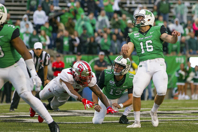 FILE - In this Oct. 26, 2019, file photo, Marshall kicker Justin Rohrwasser (16) hits a 53-yard game winning field goal against Western Kentucky during an NCAA college football game in Huntington, W.Va. New Patriots kicker Justin Rohrwasser says a tattoo on his arm is not representative of a loosely organized right-wing militia group that has adopted the symbol. Rohrwasser, who played at Rhode Island and Marshall, was taken 159th overall in the fifth round of the draft Saturday, April 25, 2020. (Sholten Singer/The Herald-Dispatch via AP, File)