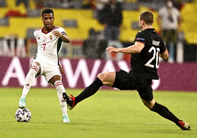 Hungary's Loic Nego, left, and Germany's Robin Gosens challenge for the ball during the Euro 2020 soccer championship group F match between Germany and Hungary at the Allianz Arena in Munich, Germany,Wednesday, June 23, 2021. (Lukas Barth/Pool Photo via AP)