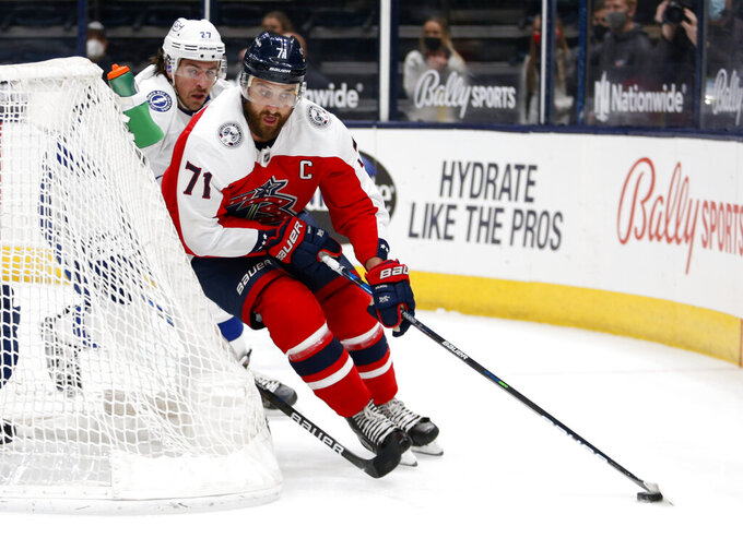 Columbus Blue Jackets forward Nick Foligno, right, controls the puck in front of Tampa Bay Lightning defenseman Ryan McDonagh during the second period of an NHL hockey game in Columbus, Ohio, Tuesday, April 6, 2021. (AP Photo/Paul Vernon)