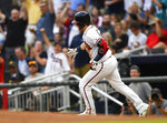 Atlanta Braves' Josh Donaldson rounds first base during his home run against the Pittsburgh Pirates in the second inning of a baseball game Tuesday June 11, 2019, in Atlanta. (AP Photo/John Amis)