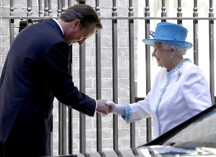 """FILE - In this Tuesday, July 24, 2012 file photo, Britain's Queen Elizabeth II is greeted by Britain's Prime Minister David Cameron, as she arrives for lunch at Downing Street in London. Former Prime Minister David Cameron said Thursday Sept. 19, 2019, that he asked Queen Elizabeth II to help the pro-""""remain"""" side in Scotland's 2014 independence referendum. (AP Photo/Kirsty Wigglesworth, File)"""