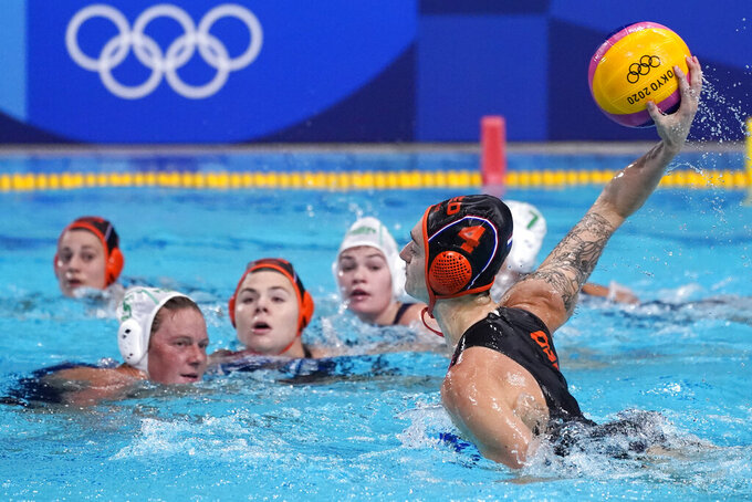 Netherland's Sabrina van der Sloot (4) shoots against South Africa during a preliminary round women's water polo match at the 2020 Summer Olympics, Friday, July 30, 2021, in Tokyo, Japan. (AP Photo/Mark Humphrey)