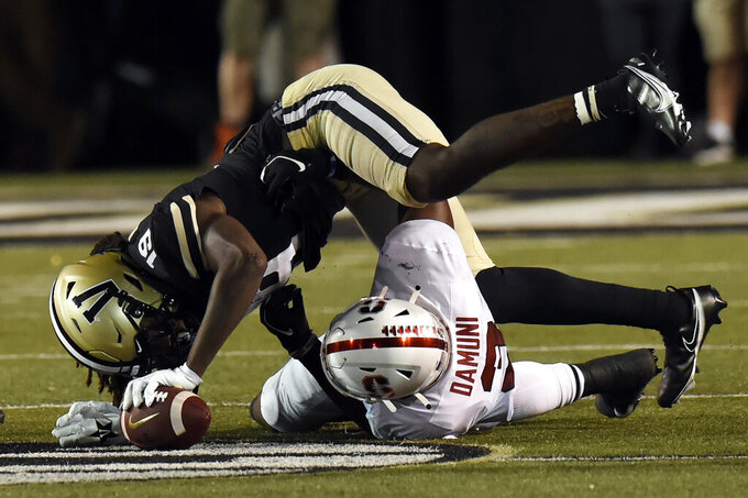 Vanderbilt wide receiver Chris Pierce Jr. (19) is tackled by Stanford linebacker Levani Damuni (3) after catching a pass in the first half of an NCAA college football game Saturday, Sept. 18, 2021, in Nashville, Tenn. (AP Photo/Mark Zaleski)