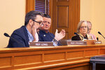 Kansas state Rep. Jason Probst, D-Hutchinson, left, makes a point about a bill on single-use plastic bags and straws as other members of the House commerce committee watch, Friday, Feb. 21, 2020, at the Statehouse in Topeka, Kan. The bill would bar cities and counties from banning such items for five years and Probst opposes it. (AP Photo/John Hanna)