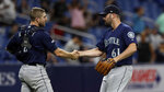 Seattle Mariners relief pitcher Matt Magill (61) shakes hands with catcher Tom Murphy (2) after closing out the Tampa Bay Rays during the ninth inning of a baseball game Tuesday, Aug. 20, 2019, in St. Petersburg, Fla. (AP Photo/Chris O'Meara)