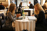 """This image released by Apple TV+ shows Jennifer Aniston, left, and Reese Witherspoon in a scene from """"The Morning Show."""" (Apple TV+ via AP)"""