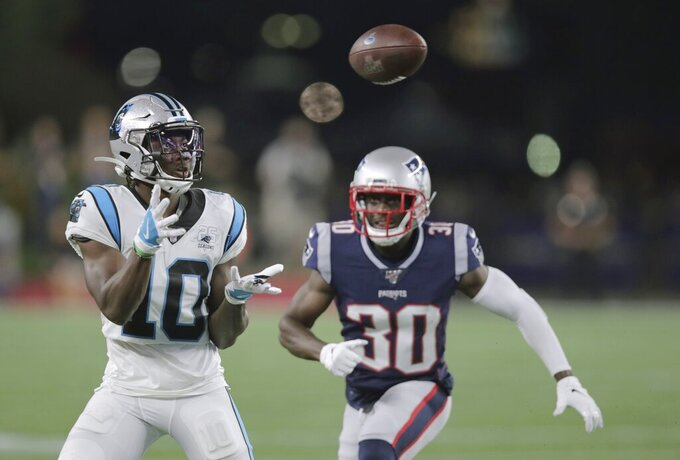 Carolina Panthers wide receiver Curtis Samuel (10) catches a pass in front of New England Patriots cornerback Jason McCourty (30) in the first half of an NFL preseason football game, Thursday, Aug. 22, 2019, in Foxborough, Mass. (AP Photo/Charles Krupa)