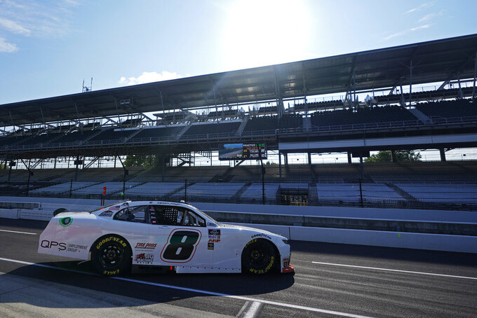 Sam Mayer pulls onto pit lane during practice for the NASCAR Xfinity Series auto race at Indianapolis Motor Speedway, Friday, Aug. 13, 2021, in Indianapolis. (AP Photo/Darron Cummings)